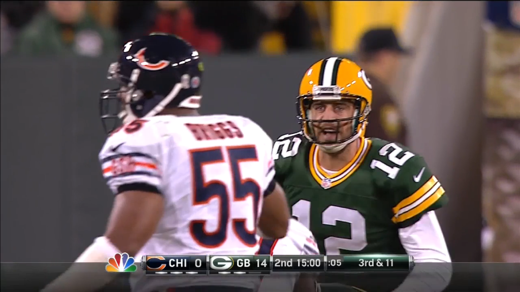 Rodgers turns to the line as Briggs yells to his teammates