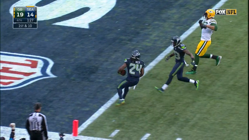Lynch is able to turn and walk backwards into the end zone.