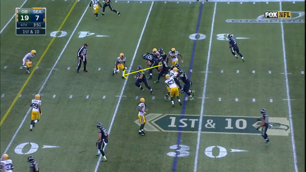 The Seahawks have bodies on bodies, allowing Lynch to exploit a crease up the middle.
