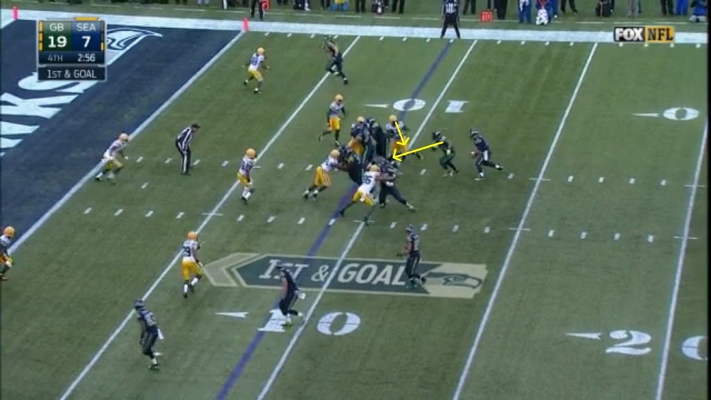 "Later in the drive, Wilson makes a questionable (unless it was a designed handoff or he was reading the defensive back) read (the option key's shoulders are turned perpendicular to the line, meaning that he cannot react to a Wilson keep, and can chase Lynch from behind).  Because the zone read is based on solid fundamentals, however, Lynch stills gains four yards.  Wilson's incorrect read became a traditional inside zone play (and any option coach will tell you that they do not expect their quarterbacks to be perfect on their reads; 75% is excellent.  The shotgun alignment, which provides the quarterback with more space for his read than a traditional under center veer scheme, should increase the quarterback's ""good read"" percentage)."
