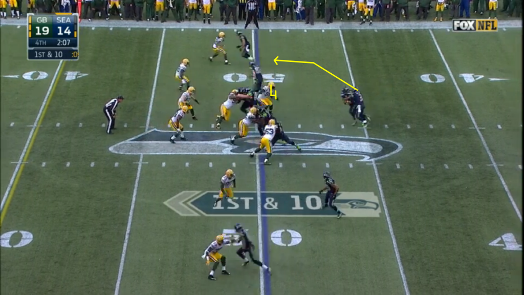 After a successful onside kick, the Seahawks start where they left off, with the zone read.  Here, Julius Peppers - one of the best defensive ends in NFL history - doesn't play it poorly.  He shuffles down the line with his shoulders parallel to the line, giving him the chance to play both options.  But his momentum down the line is too much.  Wilson keeps, starting the drive with a 15 yard gain.  Imagine how many talking heads would scoff at the notion of an NFL team starting a make or break, NFC Championship, two minute drill drive, with only one timeout remaining, with an option run.