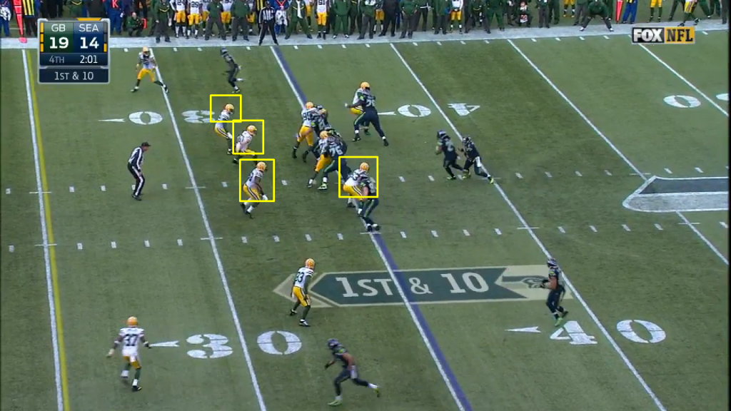 On the next play, the Seahawks - not surprisingly - went to the zone read again.  Here, the Packers play it perfectly - note how every front 7 player has his shoulders square to the line, the option key muddying Wilson's read while having the ability to react to either option.  Lynch still gains 3 on the play.