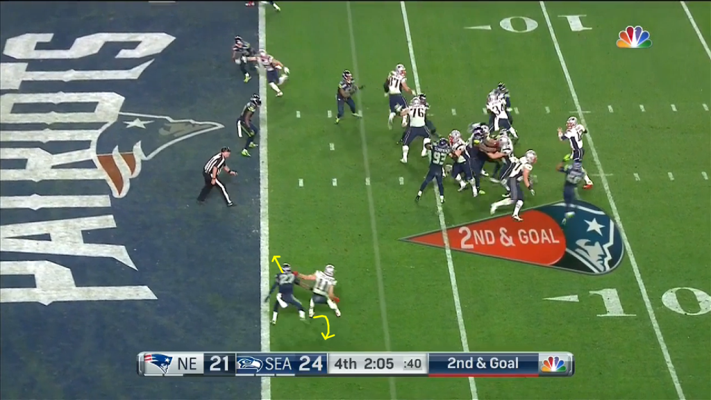 Simon's momentum is to the inside; Edelman's left arm helps Simon on his way as Edelman quickly pivots to the outside; the 6'3'' Simon can't keep up.